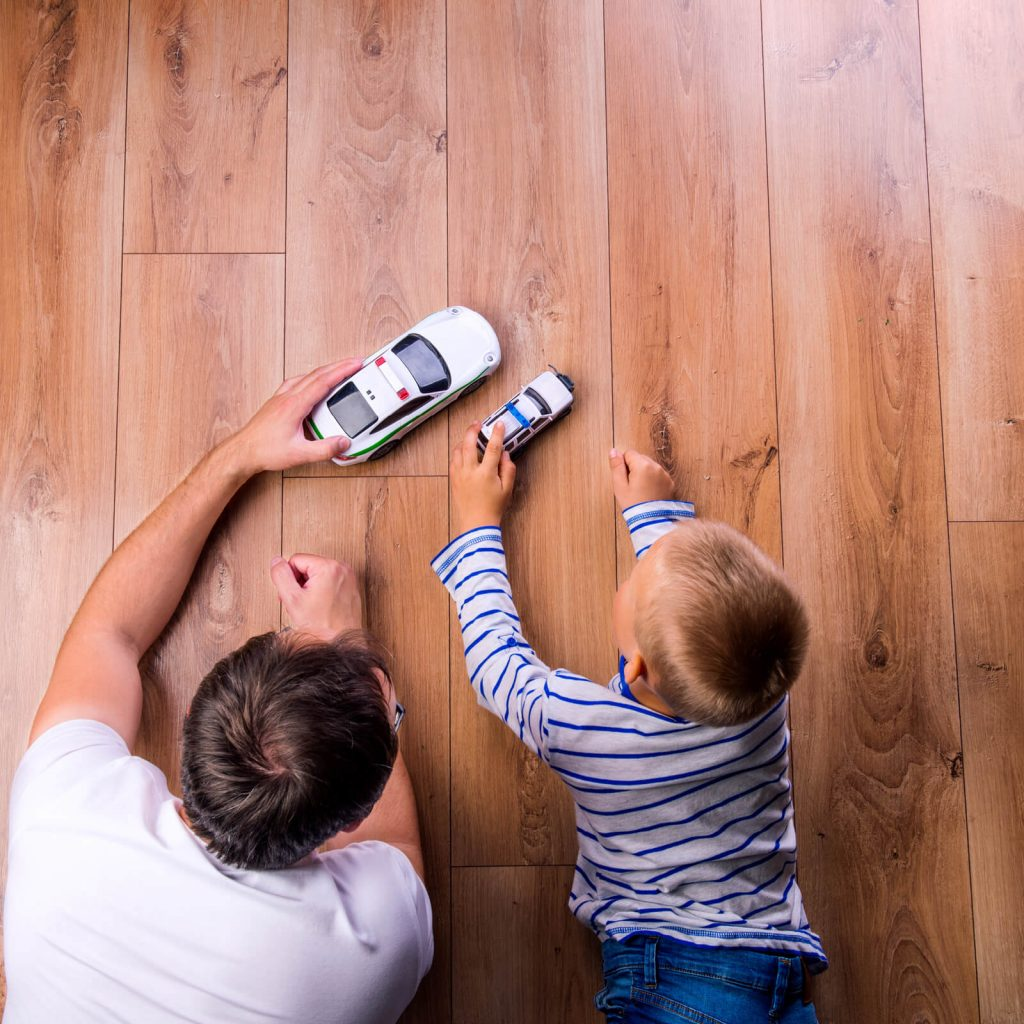 Father and kid playing with toycar | Bowling Carpet