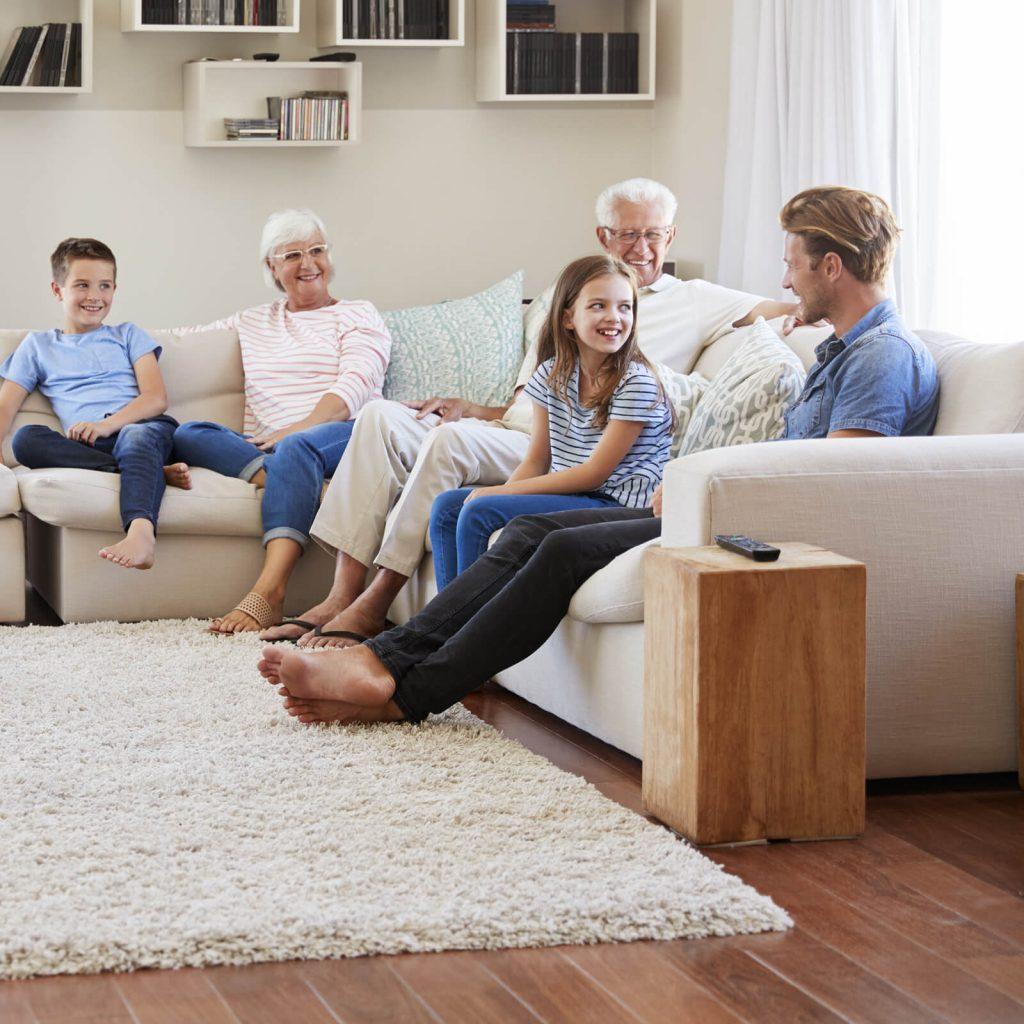 Family enjoying in living room | Bowling Carpet